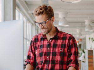 happy worker on computer