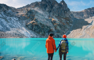 couple by body of water alaska
