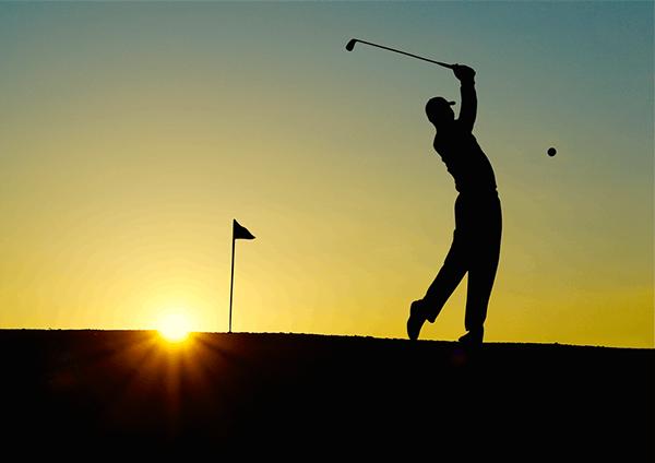 golfing at sunset
